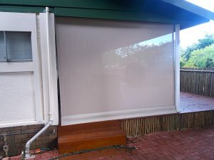 Crank Blind protects this patio from sun and adverse weather
