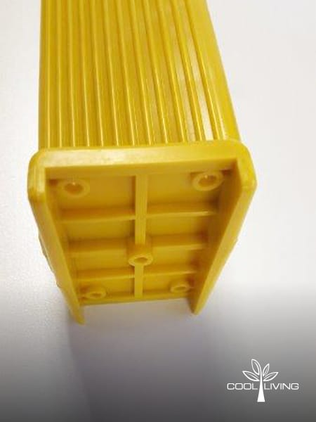 Ladder yellow step side view showing non slip ribbing and locator pin