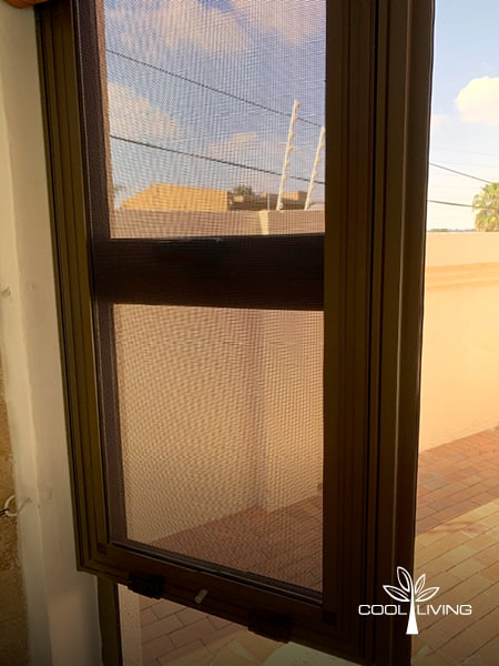 Top hung stainless steel mesh Security and Baboon Screen double window closed